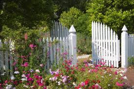 white garden fencing with double wide latch gate for easy access