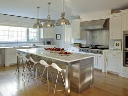 Stainless Steel Kitchen Island with Marble Countertops and Onda Barstools