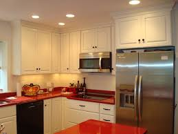 White w/ Red Countertops and Stained Accent Wall modern-kitchen