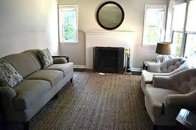 living rooms with jute rugs. large jute rug in living room. downstairs bath rooms with rugs