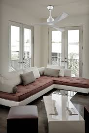 modern living room interior design using white and peach fabric sofa completed with white modern ceiling
