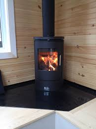 wood stove for tiny house. Classy Looking Tiny House On Wheels In Light Wood And White, With Small Stove, Stove For