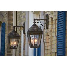 waterfall art glass panels on the two french country lantern 11 inch wide scrolled drop exterior wall lights soften the edges of the three bulbs in the