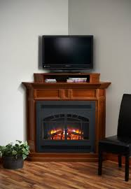 brown wwooden tv stand with fireplace and open shelf added black leather chair plaxed