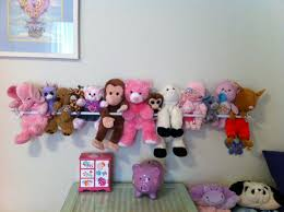 To keep toys from spreading out, let them go up! I love the stuffed animal  zoo, and this clever mama's stuffed animal barn is brilliant, too.