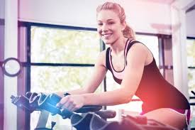 woman sitting on exercise bike