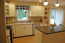 White Kitchen Cabinet Makeover View In Gallery Yellow Wood Kitchen Made Over With White Paint