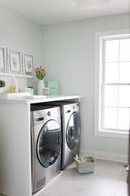 Laundry room makeovers charming small Basement Laundry Bright Mint And Marble Laundry Room Makeover With Carpet One Live The Fancy Life Beautiful And Functional White And Mint Laundry Room