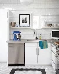 white cabinets with stainless steel countertops. Kitchens With Stainless Steel Countertops And White Subway Tile In Modern Kitchen Intended Cabinets