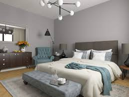 modern neutral bedroom with grey walls and blue accent fabrics