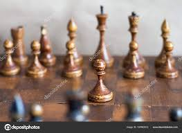 Vintage Wooden Board Games Vintage wooden chess pieces on an old chessboard Stock Photo 94