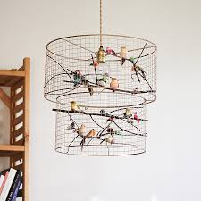 is flocked with birds in their multi colored wings the perfect piece to hang on your ceiling it will surely put a smile to every bird lover s face