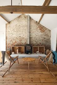 Renovated barn in England with oak floors and exposed brick wall ...