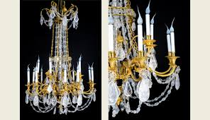 a pair of palatial antique french louis xvi gilt bronze cut rock crystal chandeliers 19th century