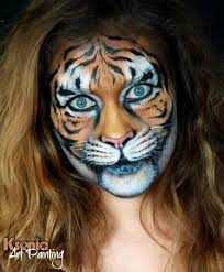 to get an easy tiger face painting look use makeup use foundation to get an even skin tone wear a dark color lipstick and black liner to draw horizontal