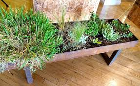 Switch out the ice bucket for a planter box in this DIY end table.