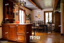 stock photo kitchen island and an old wooden dining table with high back chairs