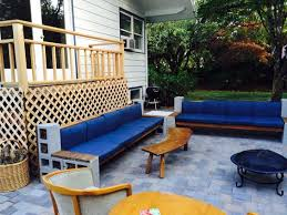 7  DIY cinder block cement sectional sofa with wood beams on paver patio