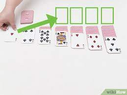How to set up solitaire with cards. How To Set Up Solitaire With Pictures Wikihow
