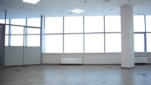 large office space. Large Office Space Is Leased. There Room For Negotiation. On The Windows We See Jalousie. Without Walls With Windows. Panoramic Shot Stock R