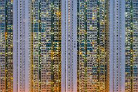 an expansive series by self taught photographer peter stewart that explores the dense urban environments and architecture of hong kong s high rise public