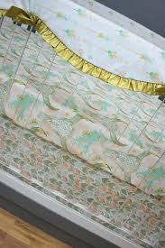 love the watercolor fl arrows and bull skull crib sheet gold mint c baby nursery bedding