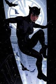 catwoman scales a gotham city building