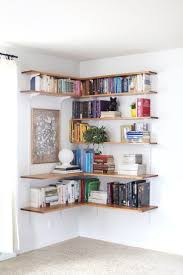 Build organize a corner shelving system; love for Lily's room in white  possibly. Get book cart out of her room and put books on Wall to save space