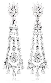 available now at firenzejewels comstunning chandelier earrings containing round pear and marquise shaped diamonds