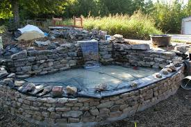 stone patio pond raised start of with and bench small ideas waterfall