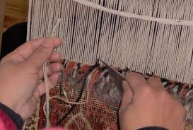 once the complete carpet has been knotted the finished piece is taken off the loom and the designs patterns are trimmed by scissors and then the pattern