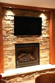 stacked stone fireplace with tv above and mantle stone fireplace with above stacked mount