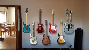 hanging a guitar on the wall