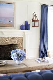 white fireplace mantle with brown mosaic glass tiles
