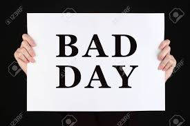 Woman Holding Poster With Text Bad Day In Front Of Her Face Isolated..  Stock Photo, Picture And Royalty Free Image. Image 51252553.