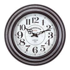 circular iron wall clock in black frame