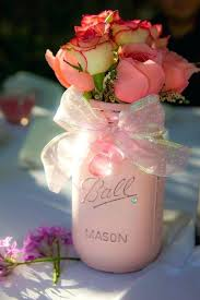 decorating with mason jars for baby shower a pink mason jar with a ribbon bow and