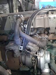 re re blown turbo volvo vn the garage journal board lines and wire rail on aswell below the egr cooler pipes are installed it s all a very tight fit so it must be held and pressed against the flange