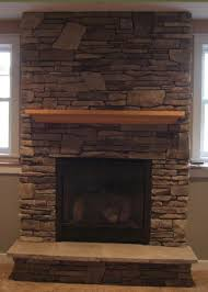 gas fireplace with cultured stone stone i d like a darker longer mantle