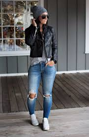 torn jeans pairing with black leather jacket and sneakers denim outfits 2019