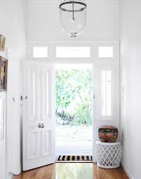 another bright and happy white color front door
