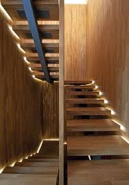 led stairway lighting. Staircase-with-lighting-along-the-sides-for-a- Led Stairway Lighting