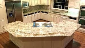 light granite countertops cream glazed cabinets