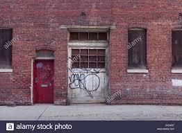 old garage door of brick building