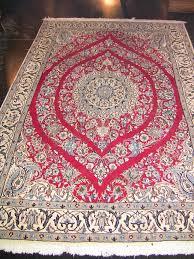 medium persian tabriz rug signed red blue cream