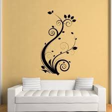 pictures wall art black sticker tree on yellow wall white sofa stripes black and white pillow