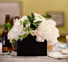 Above: Square wedding table centerpieces made of white peonies flowers and  green foliage look amazing in the black square vases.