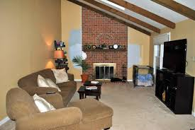 fancy paint colors for living room with red brick fireplace f76x on