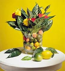 A large vase of fruit makes a very tropical centerpiece