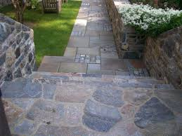 Fieldstone walls. Fieldstone flagging and steps. Full Color Bluestone  pavers with Antique Cobble inlays